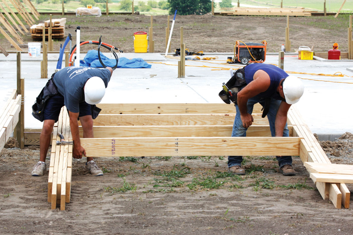 ProLine Crew Constructing Wood Frame Building